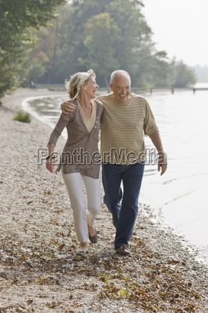 a senior couple walking along next