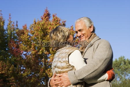 senior couple embracing in garden in