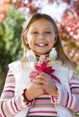 girl 7 9 standing in autumn