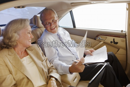 senior businessman and woman sitting in