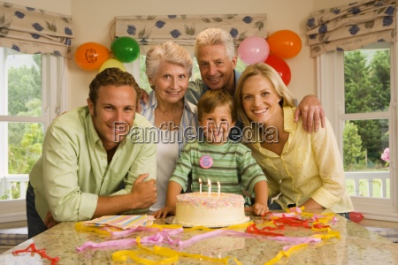 three generation family celebrating birthday at