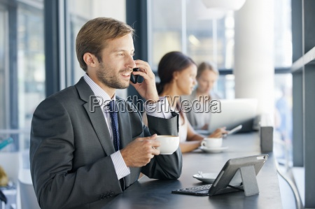 businessman talking on cell phone in