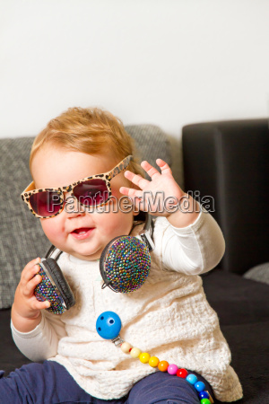 funny baby girl with headphones and