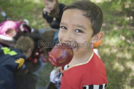 background people costume apple biting childhood