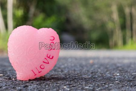love symbol on asphalt road