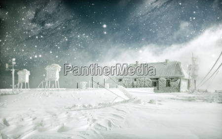 winter landscape with snowy mountain cottage