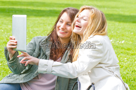 two girlfriends with tablet in the