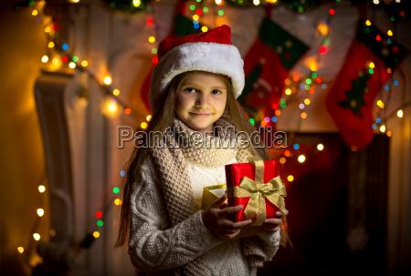 portrait of smiling girl opening sparkling