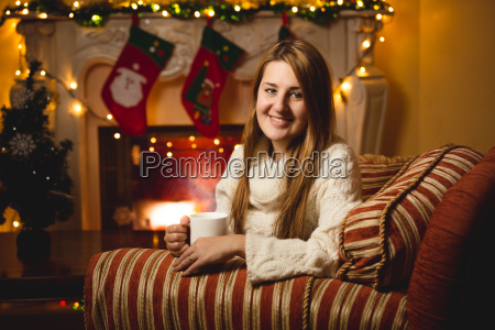 smiling woman sitting on chair at