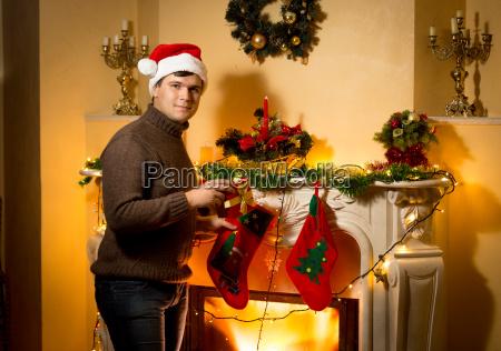 smiling man posing with gift box