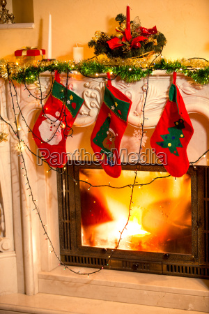 three christmas stockings hanging on decorated
