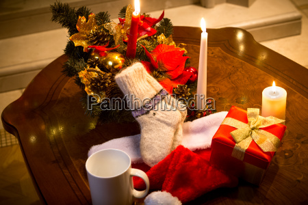 table decorated with candles and christmas