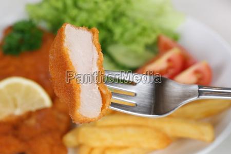 breaded wiener schnitzel dish eating with