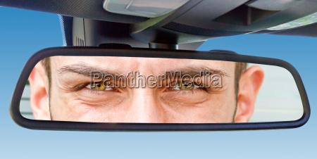 eyes in car rearview mirror