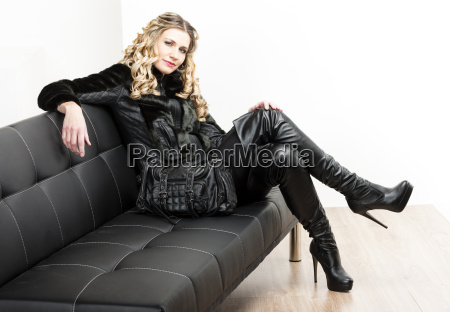 woman wearing fashionable black clothes sitting