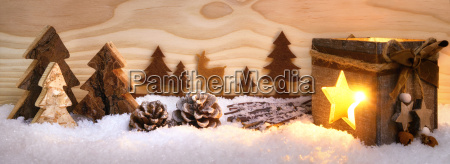 christmas scene in wood with lantern