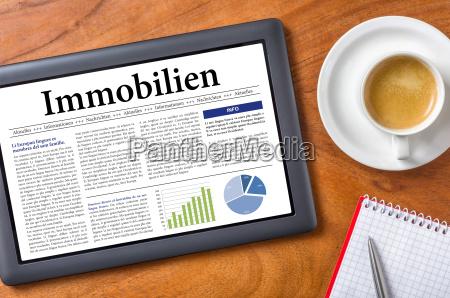 tablet on desk real estate