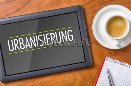 tablet on desk urbanization