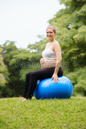 pregnant woman belly swiss fit ball