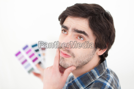 attractive young man choosing color of