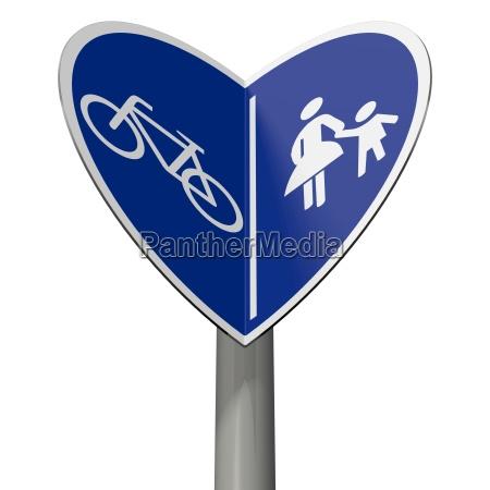 verkehrsschild fahrradweg und fussgaengerweg bildet herzchen