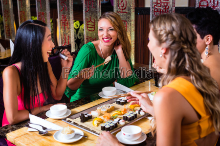 young people eating in asia restaurant