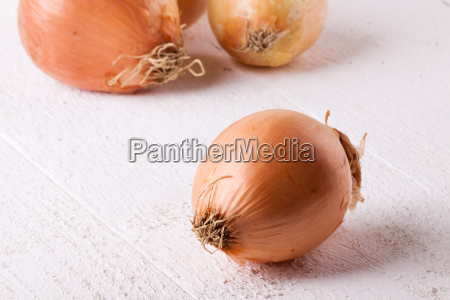 fresh onions with brown rind on