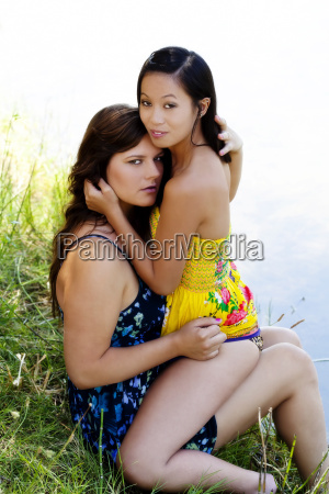 two women on river bank in