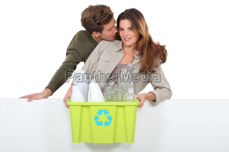 man and woman with garbage for