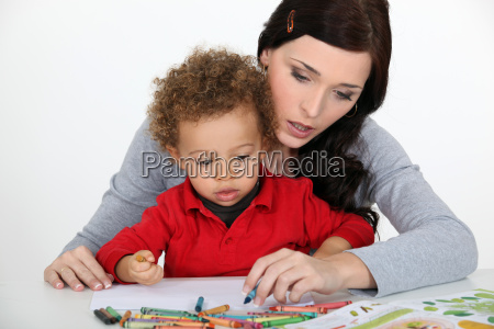 little boy and mother drawing with