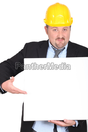 businessman in a hardhat with a
