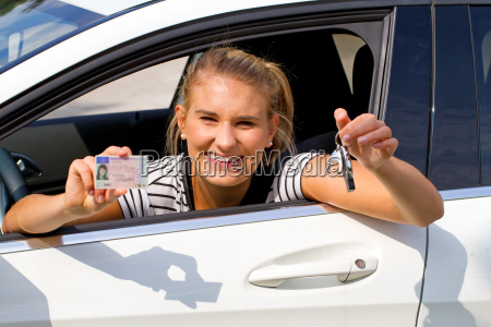 young woman in car with drivers