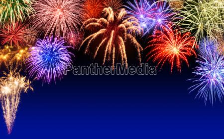 happy fireworks on dark blue