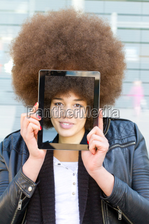 young woman with tablet with self