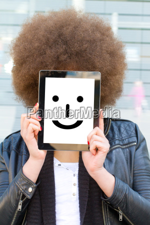 young woman with tablet and smiley