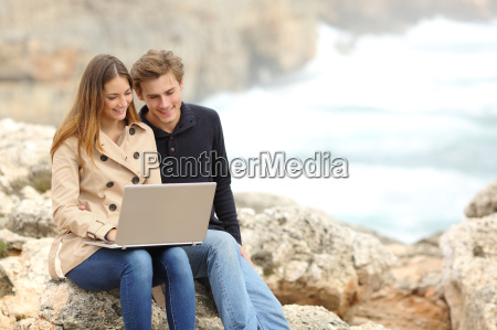 couple sharing a laptop on the