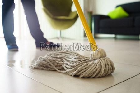 woman doing chores cleaning floor at