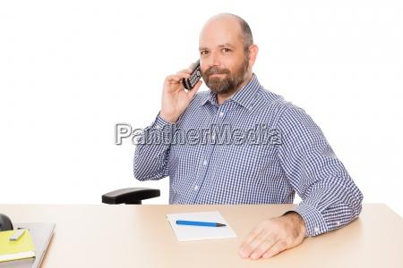 geschaeftsmann am telefon