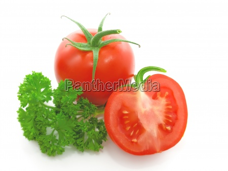red tomato with parsley isolated
