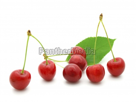 sweet cherry with a green leaf