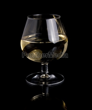 one glass white wine on black