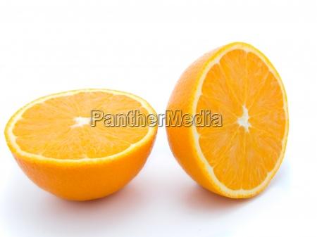 ripe two half orange fruits isolated