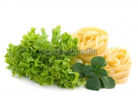fresh salad lettuce leaves and macaroni