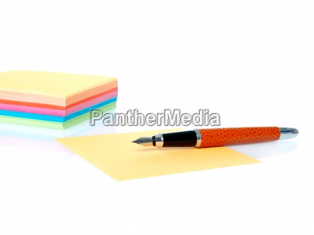 colorful empty notes and pen isolated