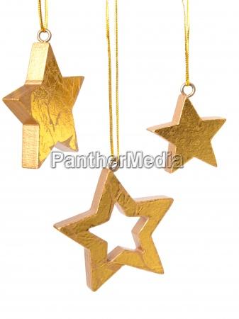 golden christmas stars isolated on white