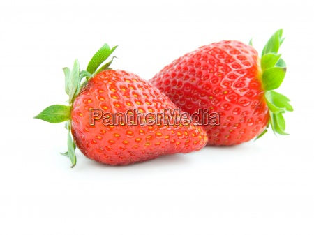 two ripe strawberries isolated on white