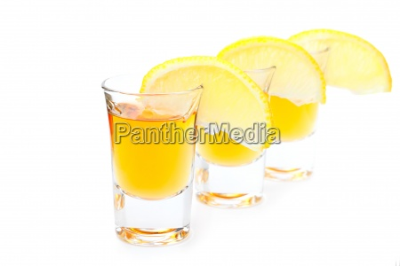 gold tequila with lime slice isolated