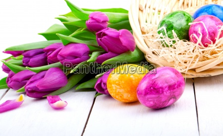 easter eggs and bouquet tulips on