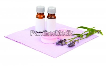 lavender oil candle and lavender flower