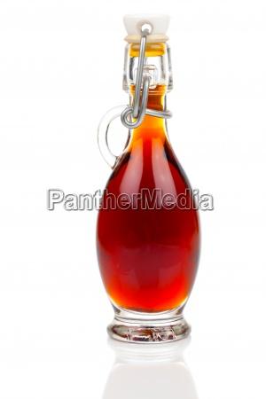 flasche von alkohol getraenk auf weissem
